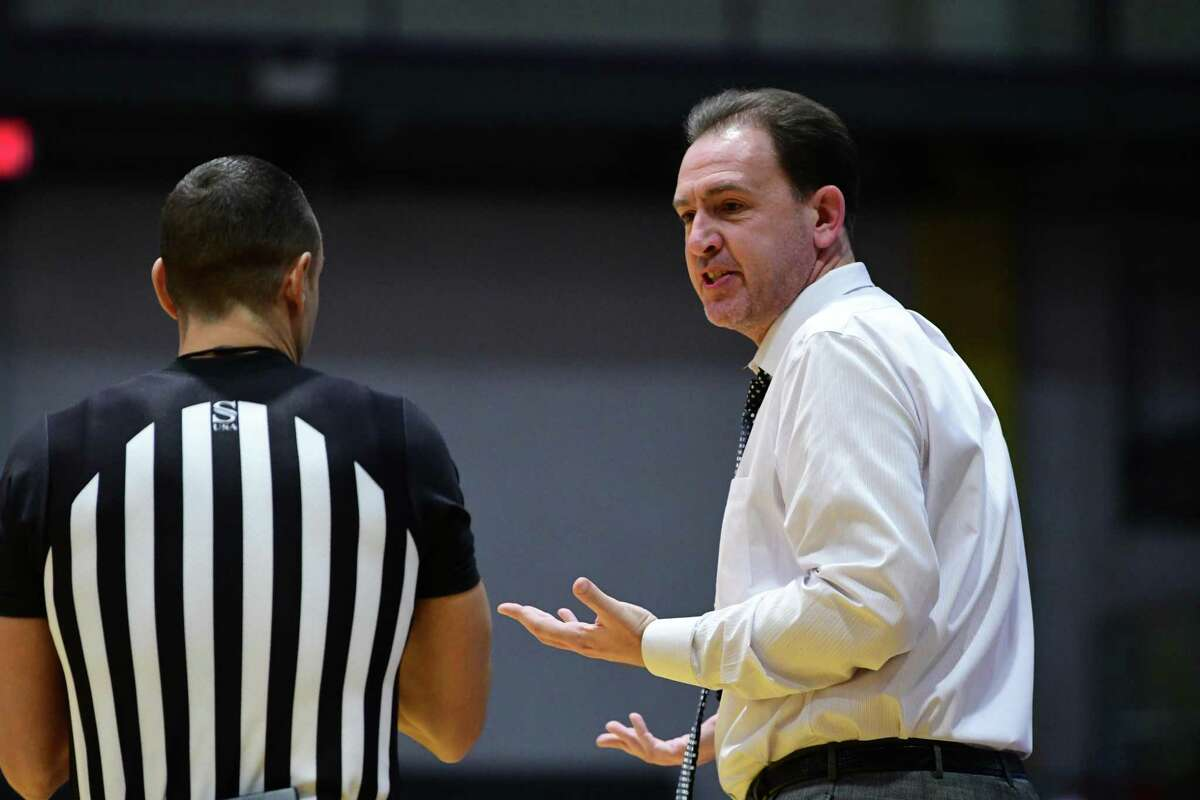 University at Albany head coach Will Brown talks with a referee during a basketball game against Potsdam at SEFCU Arena on Tuesday, Nov. 19, 2019 in Albany, N.Y. (Lori Van Buren/Times Union)