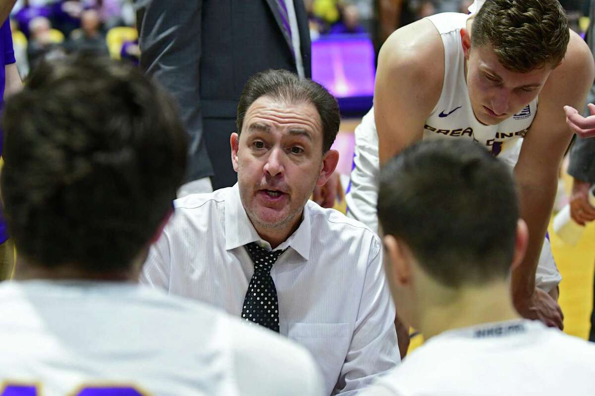 University at Albany head coach Will Brown communicates with his players at a timeout during a basketball game against Potsdam at SEFCU Arena on Tuesday, Nov. 19, 2019 in Albany, N.Y. (Lori Van Buren/Times Union)