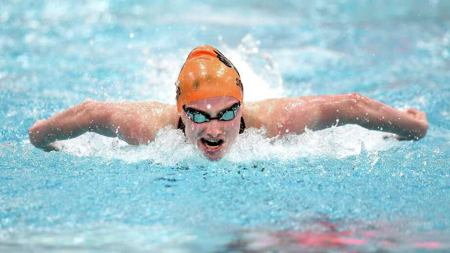 Ridgefield's Hannah Seward swims to a first-place finish in the 100-yard butterfly during the CIAC Class LL Championship at Wesleyan University in Middletown on Tuesday. For more photos and a complete recap, please visit GameTimeCT.com. Photo: Arnold Gold / Hearst Connecticut Media / New Haven Register