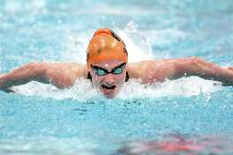 Ridgefield's Hannah Seward swims to a first-place finish in the 100-yard butterfly during the CIAC Class LL Championship at Wesleyan University in Middletown on Tuesday. For more photos and a complete recap, please visit GameTimeCT.com.