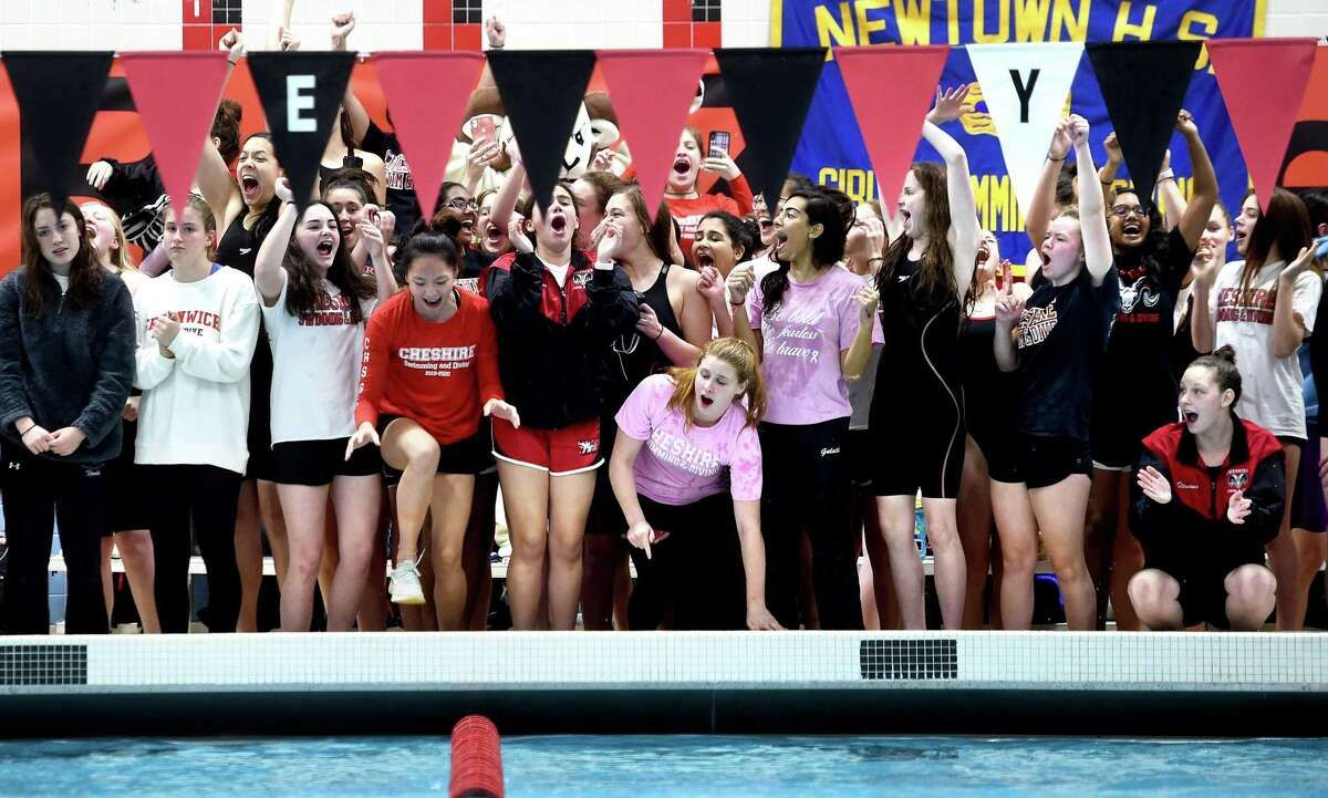 Cheshire swimmers celebrate after placing first in the 400 yard freestyle relay in the 2019 CIAC Class LL Championship.