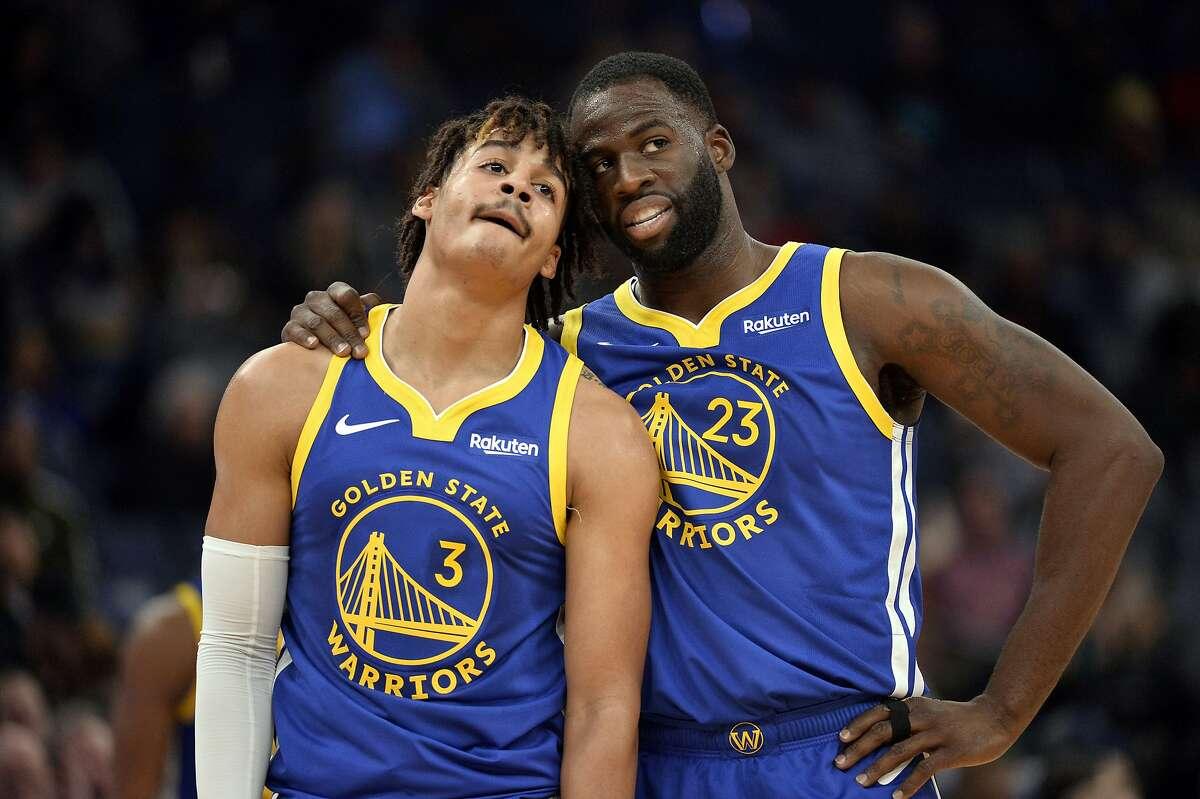 Golden State Warriors guard Jordan Poole (3) and forward Draymond Green (23) talk during a break in gameplay in the first half of an NBA basketball game Tuesday, Nov. 19, 2019, in Memphis, Tenn. (AP Photo/Brandon Dill)