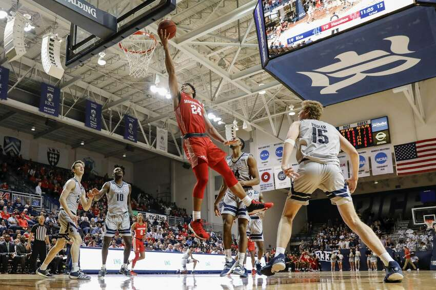 Houston Cougars guard Quentin Grimes (24) goes up for a lay up defended by Rice Owls guard Chris Mullins (24) during the first half of the NCAA basketball game between the Rice Owls and the Houston Cougars at Tudor Fieldhouse in Houston, TX on Tuesday, November 19, 2019. The Cougars defeated the Owls 97-89.