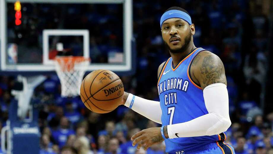 FILE - This is an April 25, 2018, file photo showing Oklahoma City Thunder forward Carmelo Anthony (7) during Game 5 of an NBA basketball first-round playoff series against the Utah Jazz, in Oklahoma City. Carmelo Anthony is done in Oklahoma City. A person with knowledge of the details tells The Associated Press the Thunder are sending the veteran NBA forward and a 2022 protected first-round pick to Atlanta in exchange for Hawks guard Dennis Schroder and Mike Muscala. (AP Photo/Sue Ogrocki, File) Photo: Sue Ogrocki / AP2018
