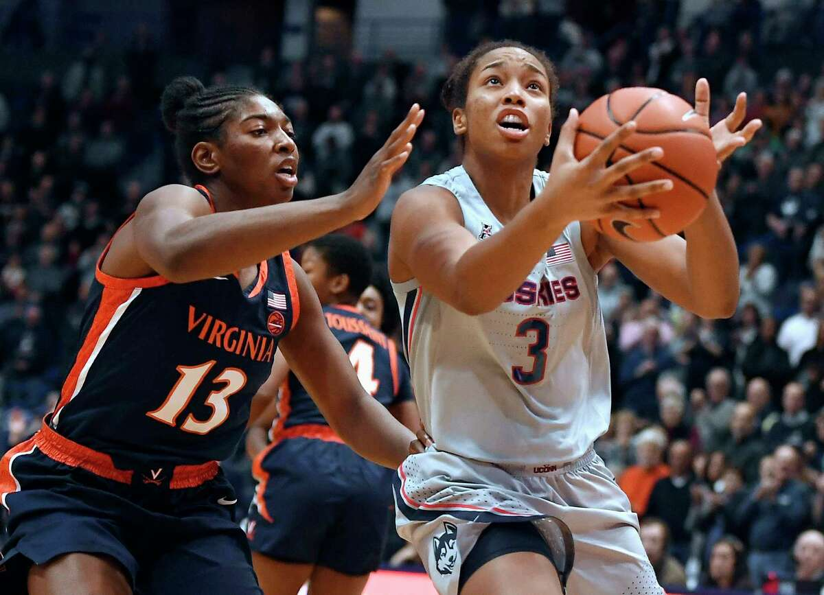 Connecticut's Megan Walker (3) is guarded by Virginia's Jocelyn Willoughby (13) during the first half of an NCAA college basketball game, Tuesday, Nov. 19, 2019, in Hartford, Conn. (AP Photo/Jessica Hill)