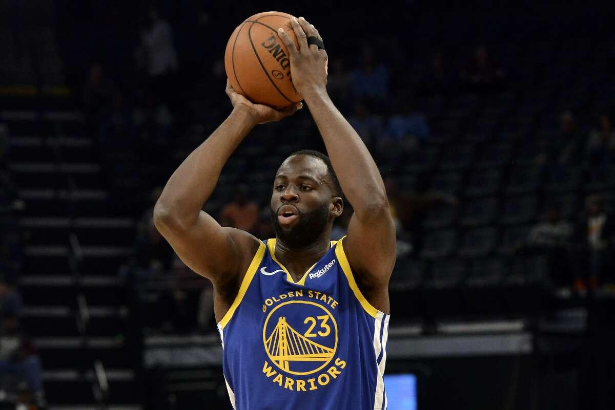 Golden State Warriors forward Draymond Green (23) handles the ball in the first half of an NBA basketball game against the Memphis GrizzliesTuesday, Nov. 19, 2019, in Memphis, Tenn. (AP Photo/Brandon Dill)