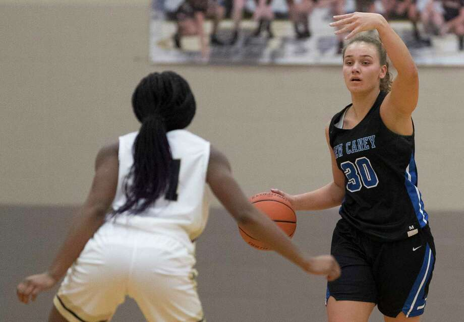 New Caney power forward Abigail Lynch (30), shown here last week during the Conroe Lady Tiger Classic, hit the game-winning 3-pointer and totaled 11 points against Kingwood Tuesday night. Photo: Jason Fochtman, Houston Chronicle / Staff Photographer / Houston Chronicle