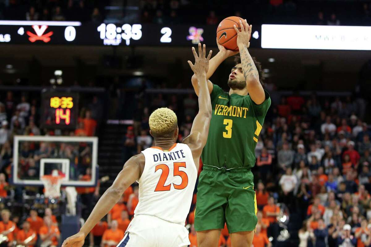 CHARLOTTESVILLE, VA - NOVEMBER 19: Anthony Lamb #3 of the Vermont Catamounts shoots over Mamadi Diakite #25 of the Virginia Cavaliers in the first half during a game at John Paul Jones Arena on November 19, 2019 in Charlottesville, Virginia. (Photo by Ryan M. Kelly/Getty Images)