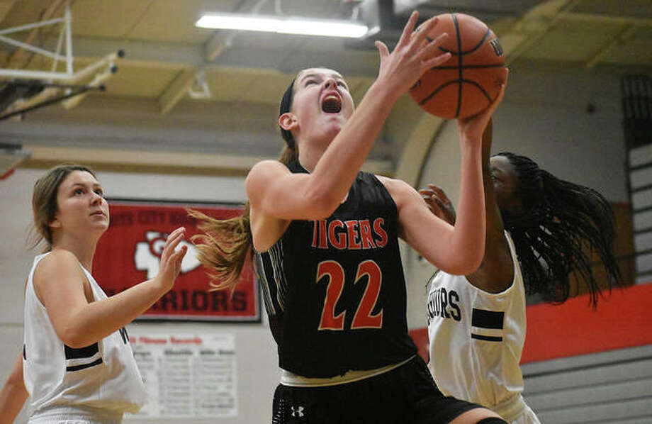 Edwardsville's Katelynne Roberts goes up for a layup between two Granite City defenders in the first quarter. Photo: Matt Kamp|The Intelligencer