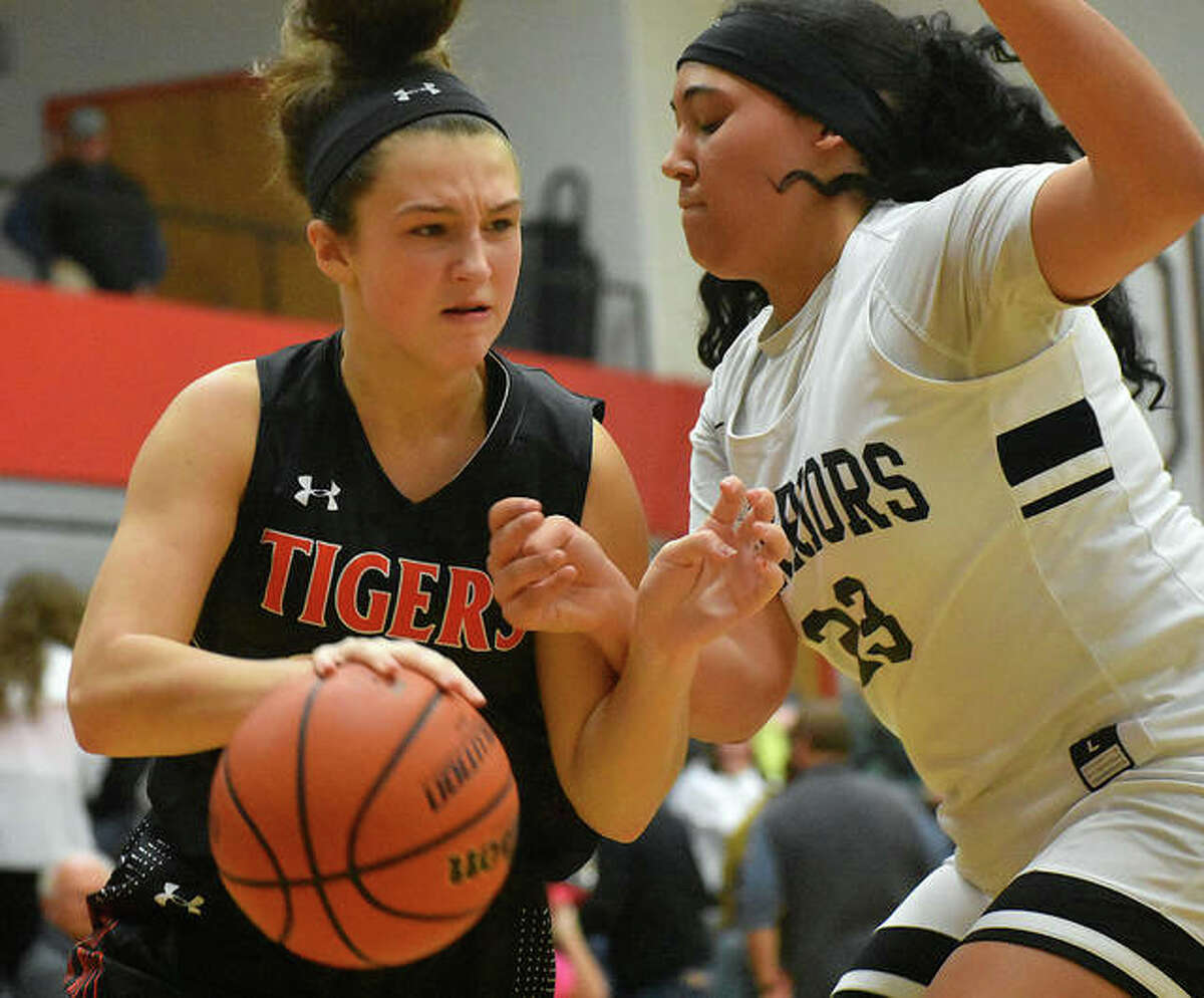 Edwardsville's Macy Silvey, left, tries to drive the baseline in the second quarter.