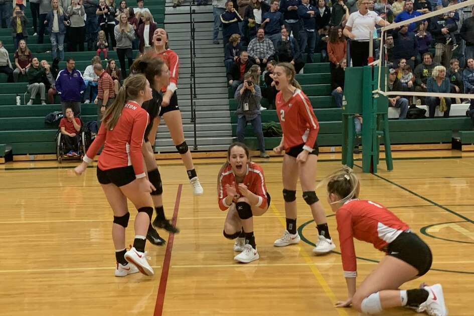 Beaverton's volleyball team celebrates match point during Tuesday's quarterfinal win over Traverse City St. Francis.