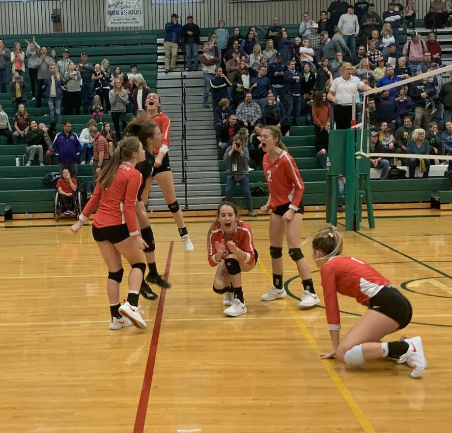 Beaverton's volleyball team celebrates match point during Tuesday's quarterfinal win over Traverse City St. Francis. Photo: Fred Kelly/fred.kelly@mdn.net