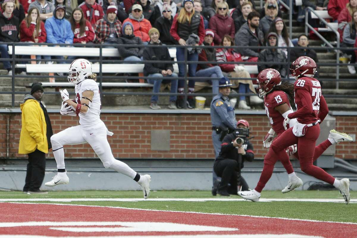 Stanford wide receiver Simi Fehoko, left, runs for a touchdown in front of Washington State linebacker Jahad Woods, center, and safety Bryce Beekman during the first half of an NCAA college football game in Pullman, Wash., Saturday, Nov. 16, 2019. (AP Photo/Young Kwak)