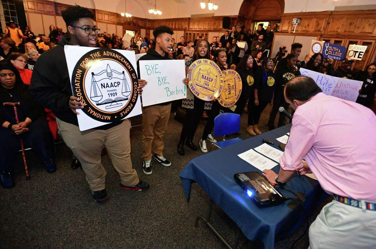 Members of the public, the NAACP and the Norwalk Board of Education square off at the Board of Education meeting Tuesday, November 19, 2019, where members were sworn in and the Norwalk NAACP urged the resignation of former BOE Chair Mike Barbis in the Norwalk City Hall Community Room in Norwalk, Conn.