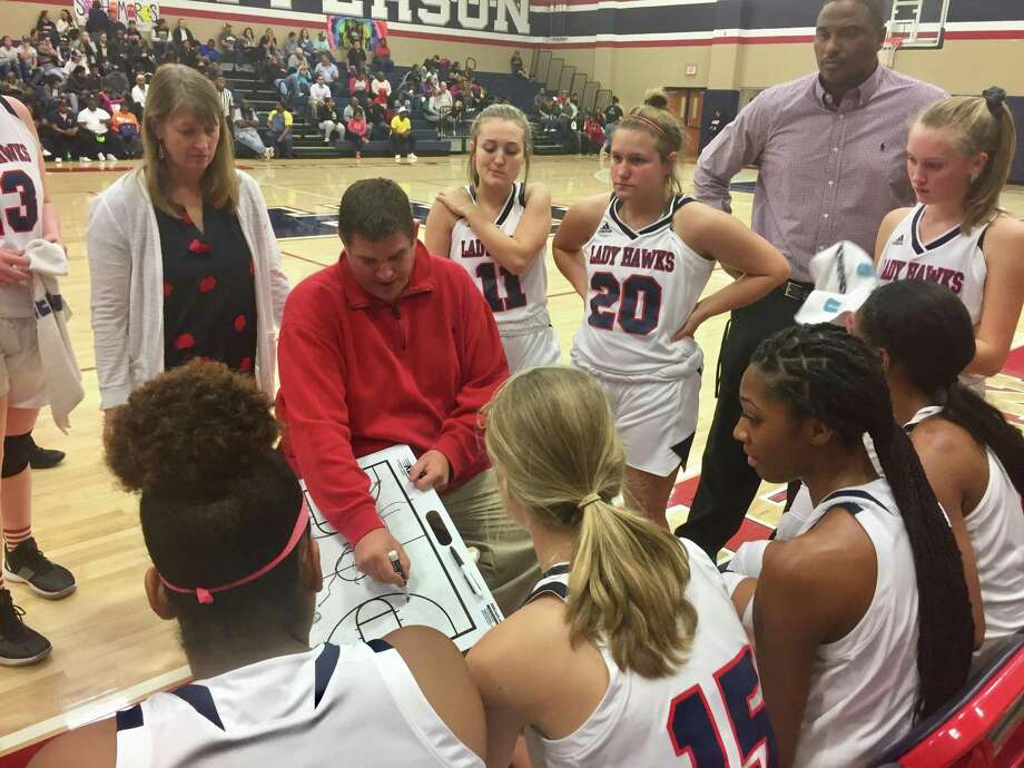 Hardin-Jefferson girls basketball coach Mike Fogo draws up a play during the Lady Hawks' win over Woodville on Tuesday night in Sour Lake. Photo: Matt Faye/The Enterprise