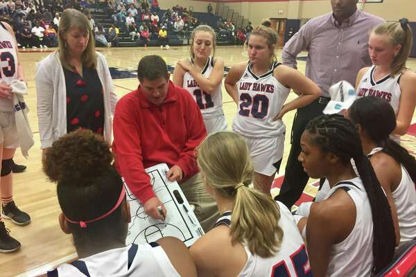 Hardin-Jefferson girls basketball coach Mike Fogo draws up a play during the Lady Hawks' win over Woodville on Tuesday night in Sour Lake.