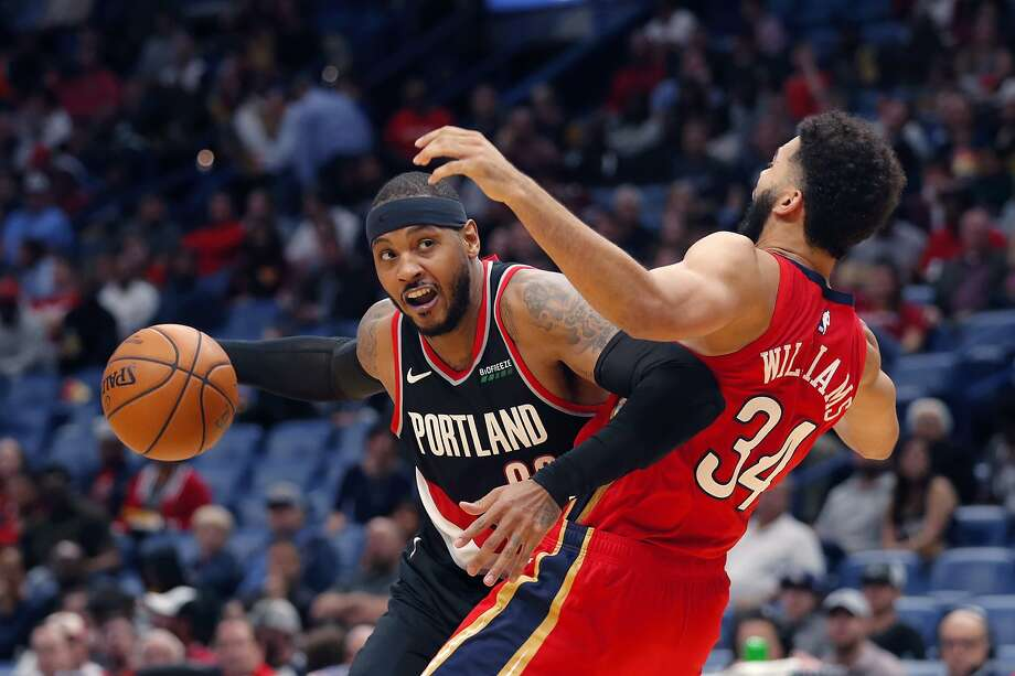 Trail Blazers forward Carmelo Anthony is defended by Pelicans forward Kenrich Williams during the second half in New Orleans. Anthony scored 10 points in his return to the NBA after not having played since Nov. 8, 2018, with the Rockets. Photo: Gerald Herbert / Associated Press