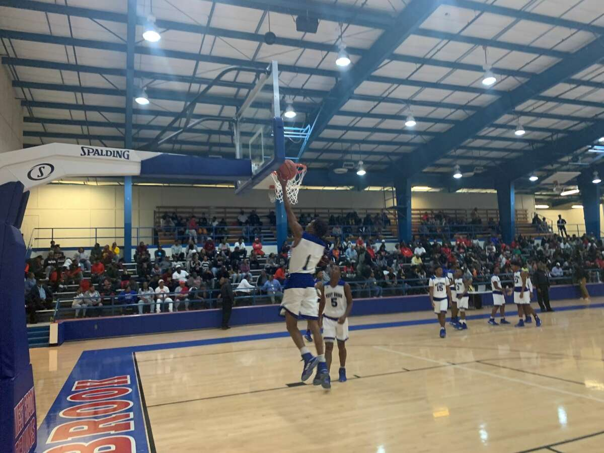 West Brook basketball players warmup before their home game against Port Arthur Memorial on Tuesday night.