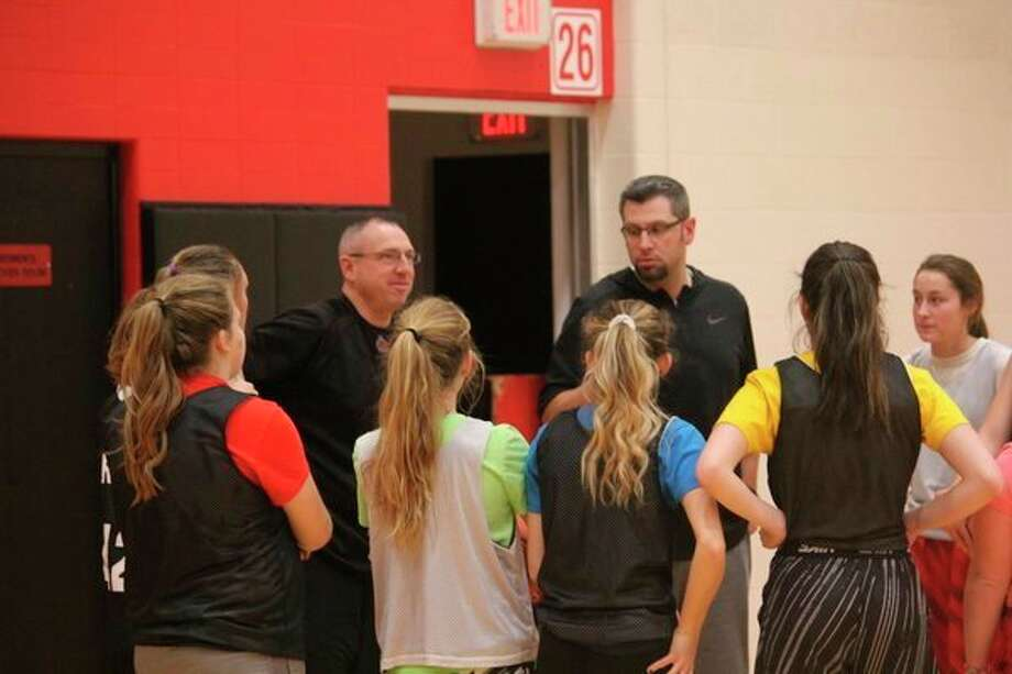 Coach Tim Beilfuss (right) talks to his players last week after a Reed City girls basketball practice. (Herald Review photo/John Raffel)