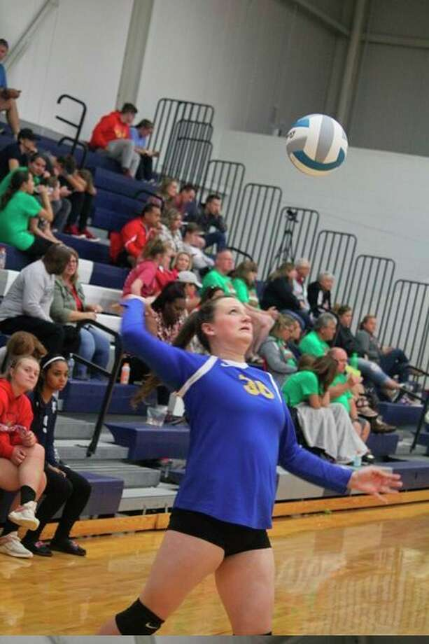 Kelci Elder keeps an eye on the ball during Evart volleyball action this season. (Herald Review photo)