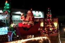 Santa Claus and others make their way through Auburn during its second annual Christmas Parade of Lights in 2018. This year's event is scheduled for Saturday, Dec. 14, and will help raise funds for the Toni and Trish House for the Care of the Terminally Ill.
