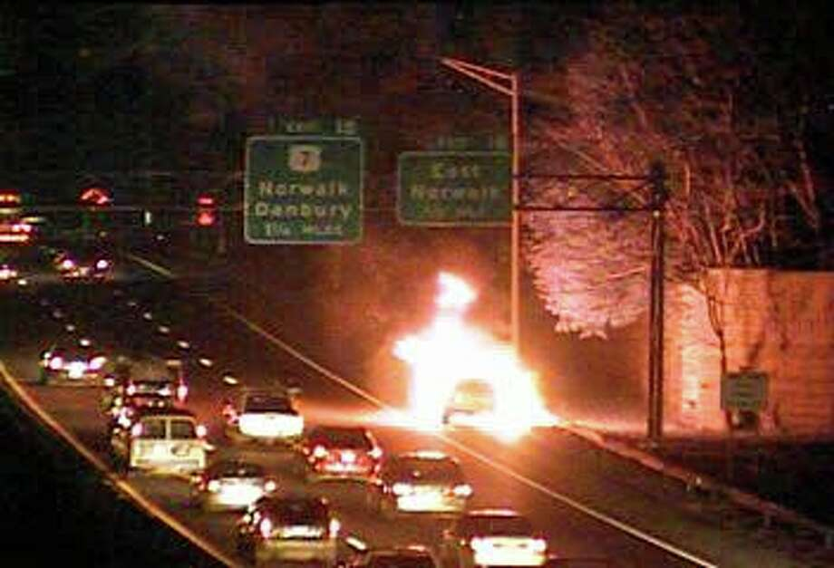 Firefighters from Norwalk and Westport battled an intense car fire on southbound I-95 Wednesday morning on Nov. 20, 2019. No injuries were reported.