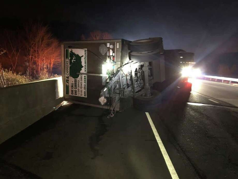 """A double tractor-trailer truck flipped on its side on I-84 in Southbury Tuesday night on Nov. 19, 2019. """"At 8:14pm, Southbury Fire was dispatched to a motor vehicle accident on Interstate 84 East,"""" firefighters posted on their Facebook page. Upon arrival, Chief Brian Warren found a double tractor trailer with the rear trailer on its side. Photo: Southbury Fire Department Photo"""