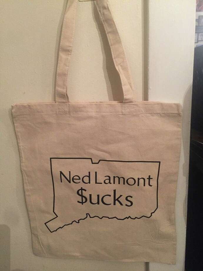 "Taylor Viele, of Wallingford, is making and selling reusable shopping bags that proclaim ""Ned Lamont $ucks."" Photo: Submitted"