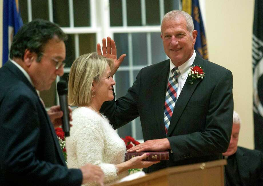 Shelton Mayor Mark A. Lauretti prepares to take the oath of office to start his 15th term during an Inauguration Ceremony at the Shelton Senior Center in Shelton, Conn., on Tuesday Nov. 19, 2019. Photo: Christian Abraham / Hearst Connecticut Media / Connecticut Post