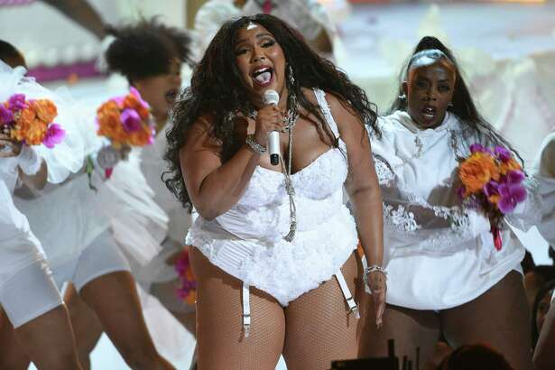 FILE - This June 23, 2019 file photo shows Lizzo performing at the BET Awards on Sunday, June 23, 2019 in Los Angeles. Singer-rapper Lizzo earned eight Grammy Award nominations, Wednesday, Nov. 20, making her the show's top-nominated act. The 62nd Grammy Awards will air live from the Staples Center in Los Angeles on January 26. (Photo by Chris Pizzello/Invision/AP, File)