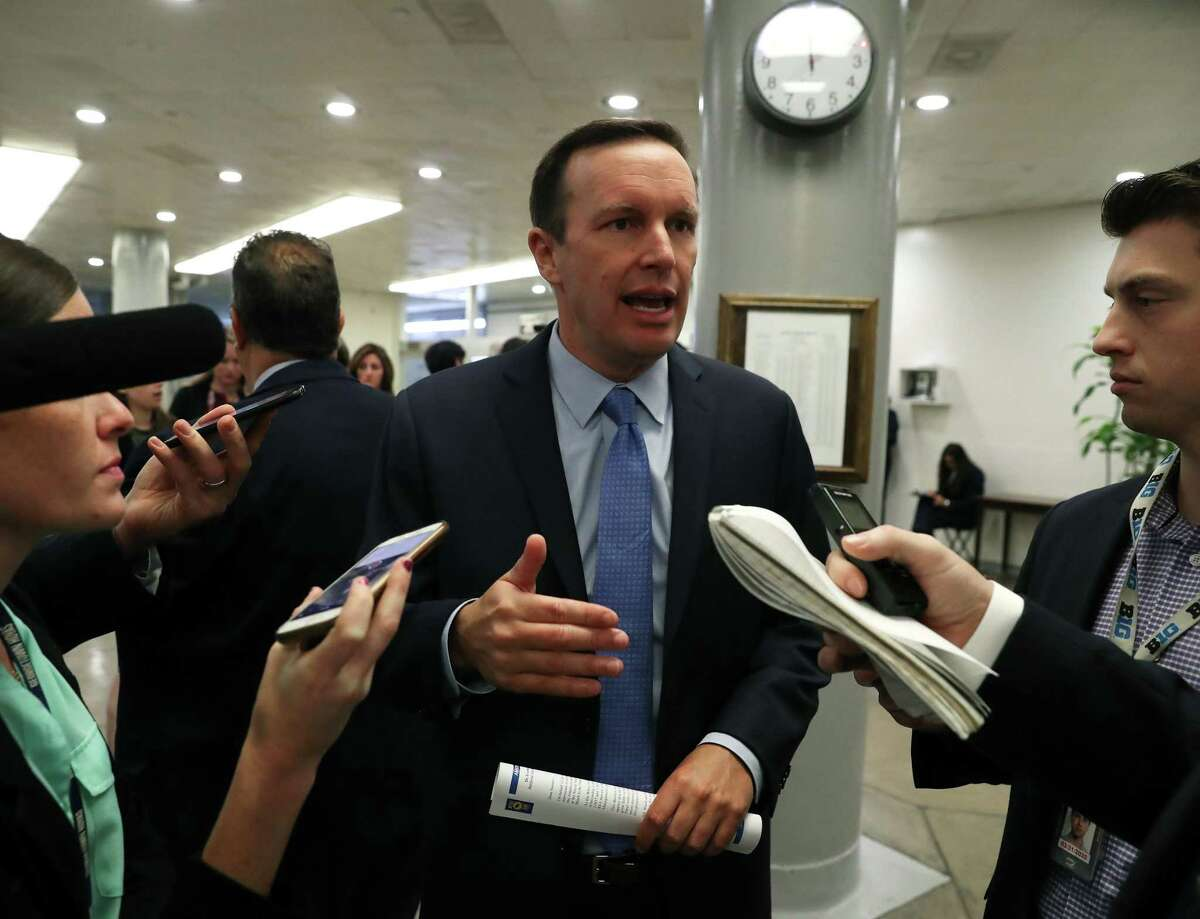 U.S. Sen. Chris Murphy, D-Conn., talks to reporters ahead of a vote before attending the weekly Senate Democrat policy luncheon on Capitol Hill Sept. 24 in Washington, DC.