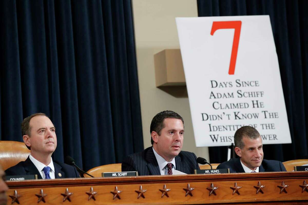 Ranking member Rep. Devin Nunes of Calif., gives his opening state before U.S. Ambassador to the European Union Gordon Sondland testifies before the House Intelligence Committee on Capitol Hill in Washington, Wednesday, Nov. 20, 2019, during a public impeachment hearing of President Donald Trump's efforts to tie U.S. aid for Ukraine to investigations of his political opponents. House Intelligence Committee Chairman Adam Schiff, D-Calif., left, and Steve Castor, right, the Republican staff attorney.
