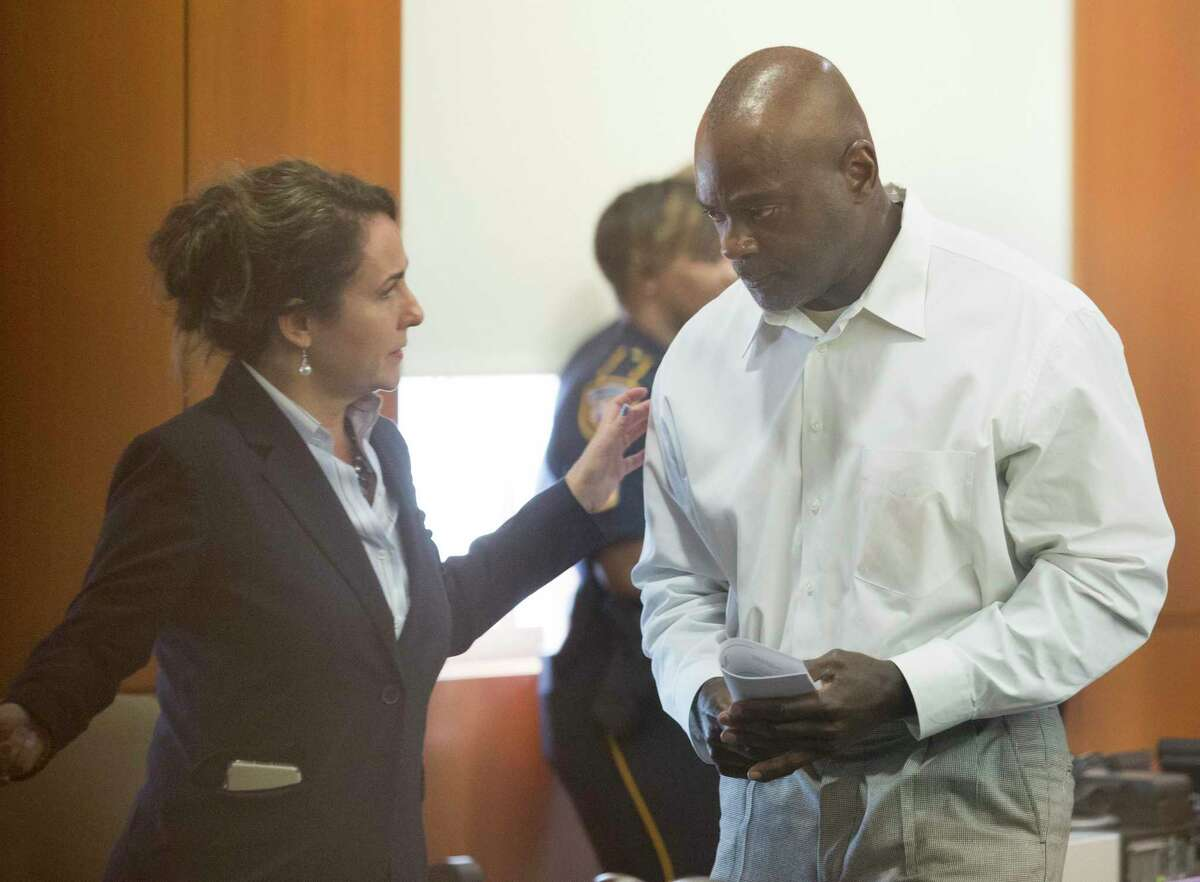 Former Houston Police Department narcotics officer Gerald Goines talks to his defense attorney Nicole DeBorde while appearing to Harris County Judge Frank Aguilar on Monday, Aug. 26, 2019, in Houston. Goines is charged with felony murder in the deaths of Dennis Tuttle and Rhogena Nicholas Steve in a botched drug raid in January.