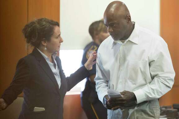 Former Houston Police Department narcotics officer Gerald Goines talks to his defense attorney Nicole DeBorde while appearing to Harris County Judge Frank Aguilar on Monday, Aug. 26, 2019, in Houston. Goines was is charged with felony murder in deaths of Dennis Tuttle and Rhogena Nicholas Steve in a botched drug raid in January.
