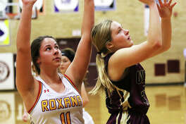 EA-WR's Taylor Parmentier (right) puts up a shot after getting behind Roxana's Kiley Winfree during the season opener for both teams Tuesday night at the Dupo Cat Classic in Dupo.