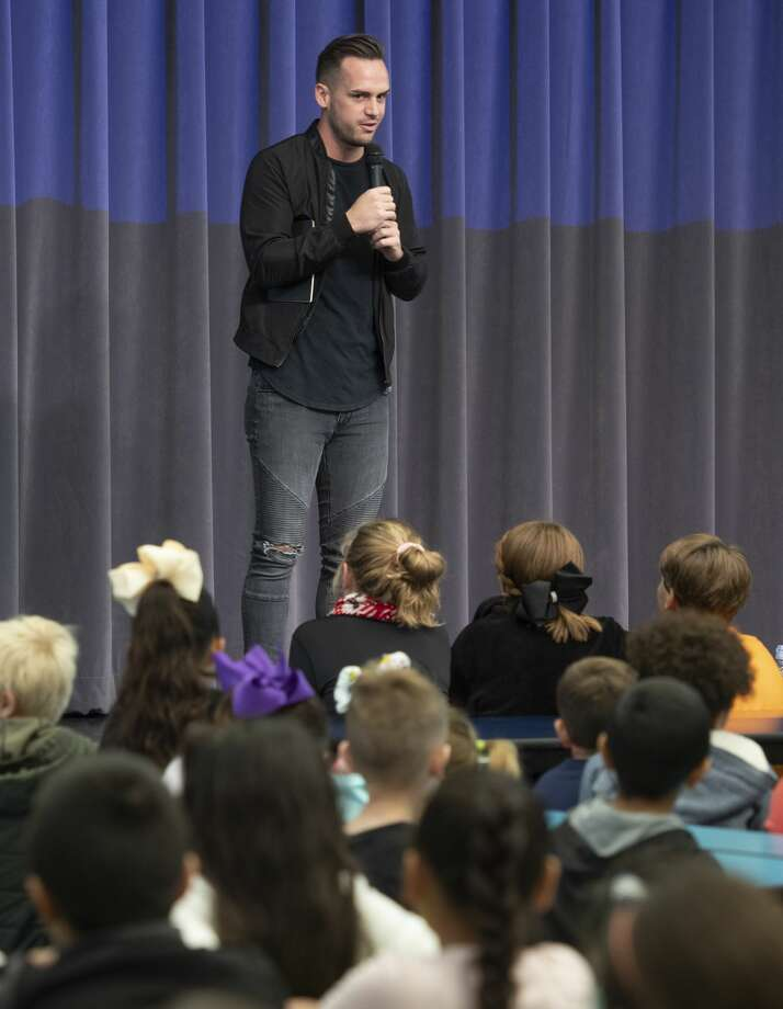 Matt New, contestant on season 17 of The Voice, speaks with students at Fasken Elementary 11/20/19 about pursuing their dreams and how his dreams led him to audition for the show. Tim Fischer/Reporter-Telegram Photo: Tim Fischer/Midland Reporter-Telegram
