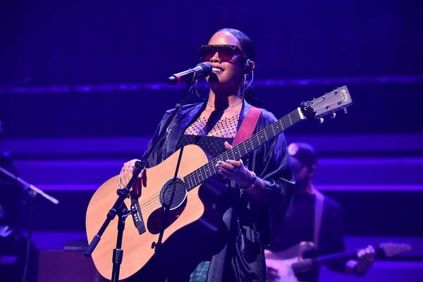 H.E.R. performs during the TIDAL's 5th Annual TIDAL X Benefit Concert TIDAL X Rock The Vote At Barclays Center - Show at Barclays Center of Brooklyn on October 21, 2019 in New York City.