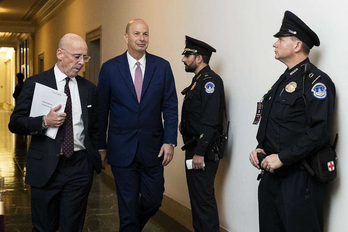 U.S. Ambassador to the European Union Gordon Sondland, second from left, walks back to the hearing room after a short break on a public impeachment hearing of President Donald Trump's efforts to tie U.S. aid for Ukraine to investigations of his political opponents on Capitol Hill in Washington, Wednesday, Nov. 20, 2019. (AP Photo/Manuel Balce Ceneta)