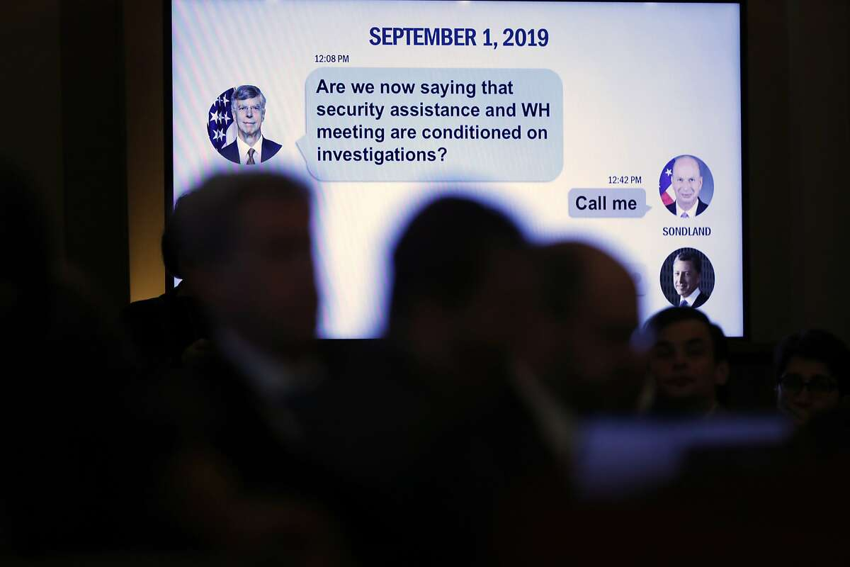 A text message is displayed on a monitor as U.S. Ambassador to the European Union Gordon Sondland testifies before the House Intelligence Committee on Capitol Hill in Washington, Wednesday, Nov. 20, 2019, during a public impeachment hearing of President Donald Trump's efforts to tie U.S. aid for Ukraine to investigations of his political opponents. (AP Photo/Andrew Harnik)