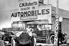 TOT: Thad R. Roberts and Harry L. Creed stand in front of C.W. Roberts Studebaker Sales in Wellington, Texas, circa 1916. One of those photos that you'd just love to be able to step into in order to see what it looked like in color. That Red Sentry gasoline pump is one of the early fuel dispensers.