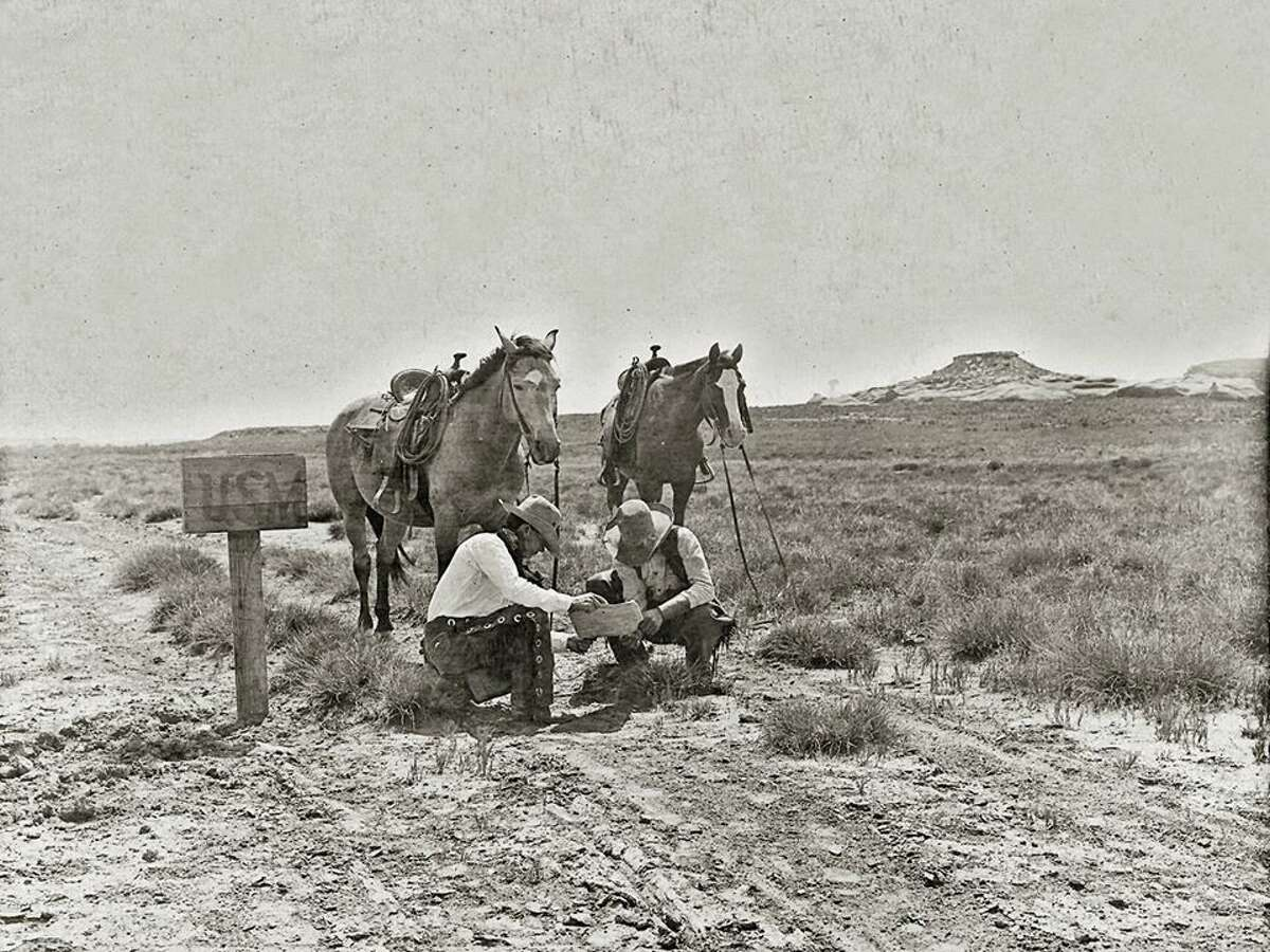 TOT: Cowboys read the newspaper at a mailbox somewhere in Texas, perhaps on the LS Ranch or the JA Ranch. It is a monumentally great photo all the way around. It was taken by noted cowboy photographer (that is to say he was both cowboy AND photographer) Erwin E. Smith.