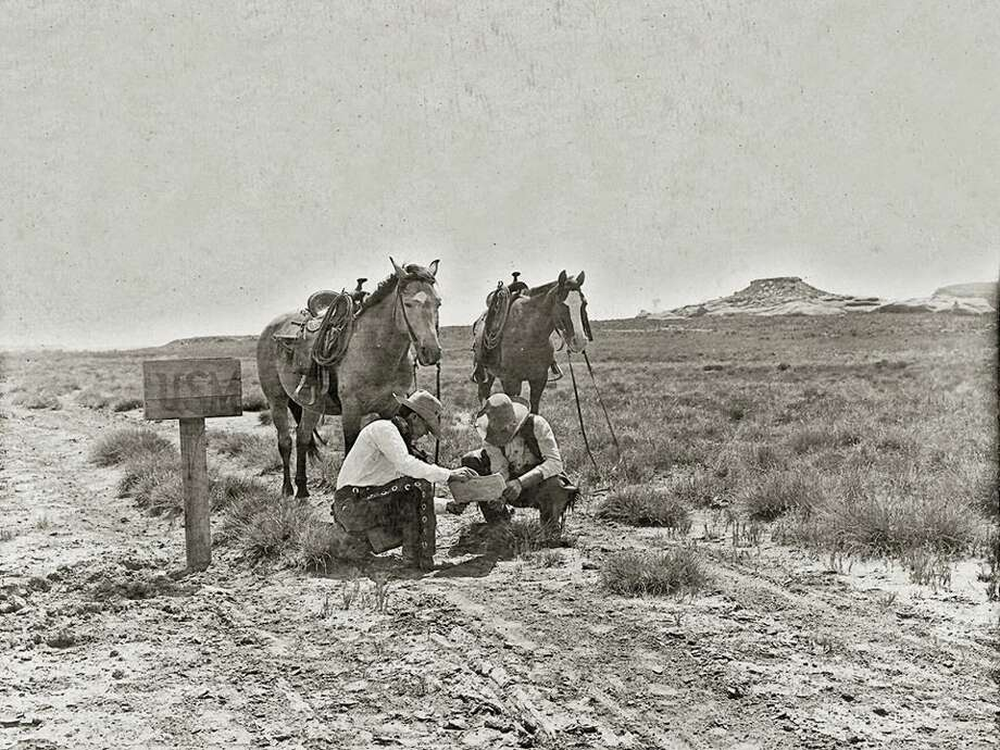 TOT: Cowboys read the newspaper at a mailbox somewhere in Texas, perhaps on the LS Ranch or the JA Ranch. It is a monumentally great photo all the way around. It was taken by noted cowboy photographer (that is to say he was both cowboy AND photographer) Erwin E. Smith. Photo: Traces Of Texas