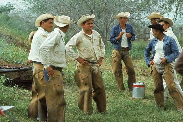 "TOT: Y'all have really ""upped your game"" in the past few days. Traces of Texas reader Juana Lopez kindly submitted this mid-1960s photo of vaqueros gathering for lunch on the King Ranch. Juana's grandfather worked on the ranch at this time but is not in this particular photo."