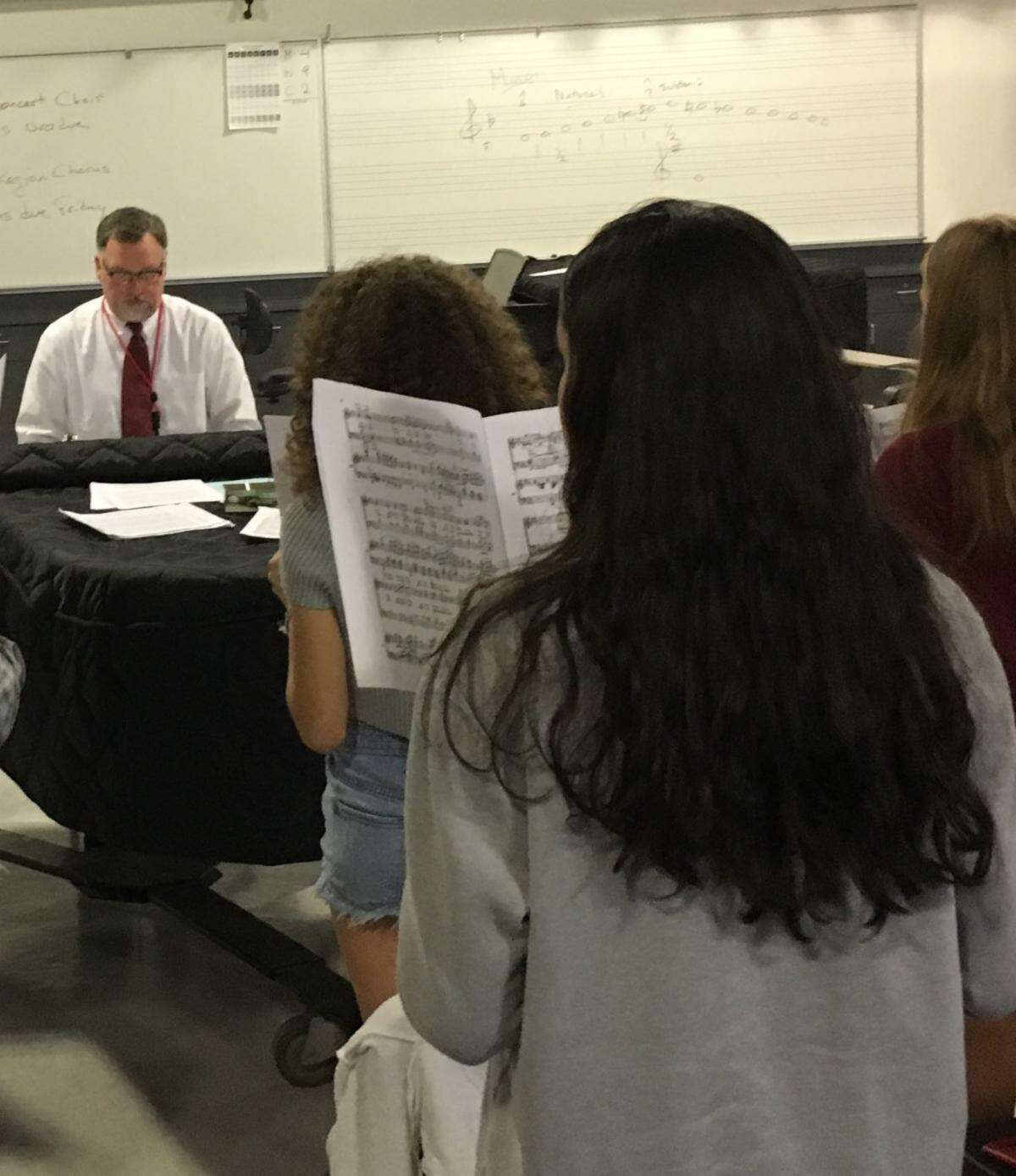 Patrick Taylor, director of Choirs at Greenwich High School, rehearses for the Greenwich Symphony concert November 23-24. The 80 singers have been working hard with the music and the German text of