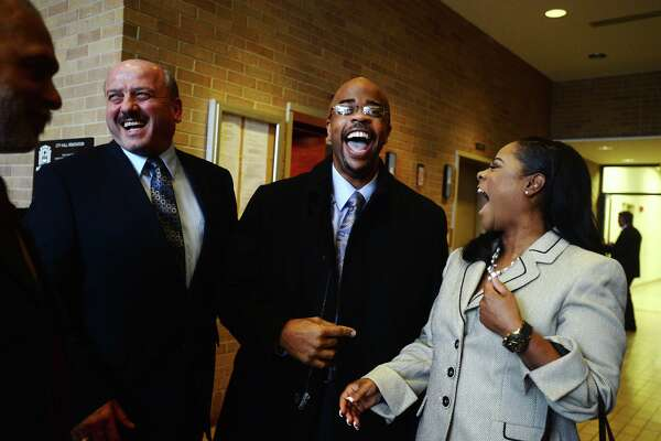 Dr. Joseph G. Majdalani, public works director, Jamie Smith, Jefferson County District Clerk, and Melanie Smith, left to right, share a laugh during a reception for William R. Sam, Sr., on Tuesday. Sam was sworn in as Ward IV councilman during the Beaumont City Council's normal meeting Tuesday afternoon. He is replacing Jamie Smith, who successfully ran for Jefferson County District Clerk, and will serve through the May election. Photo taken Tuesday 1/13/15 Jake Daniels/The Enterprise