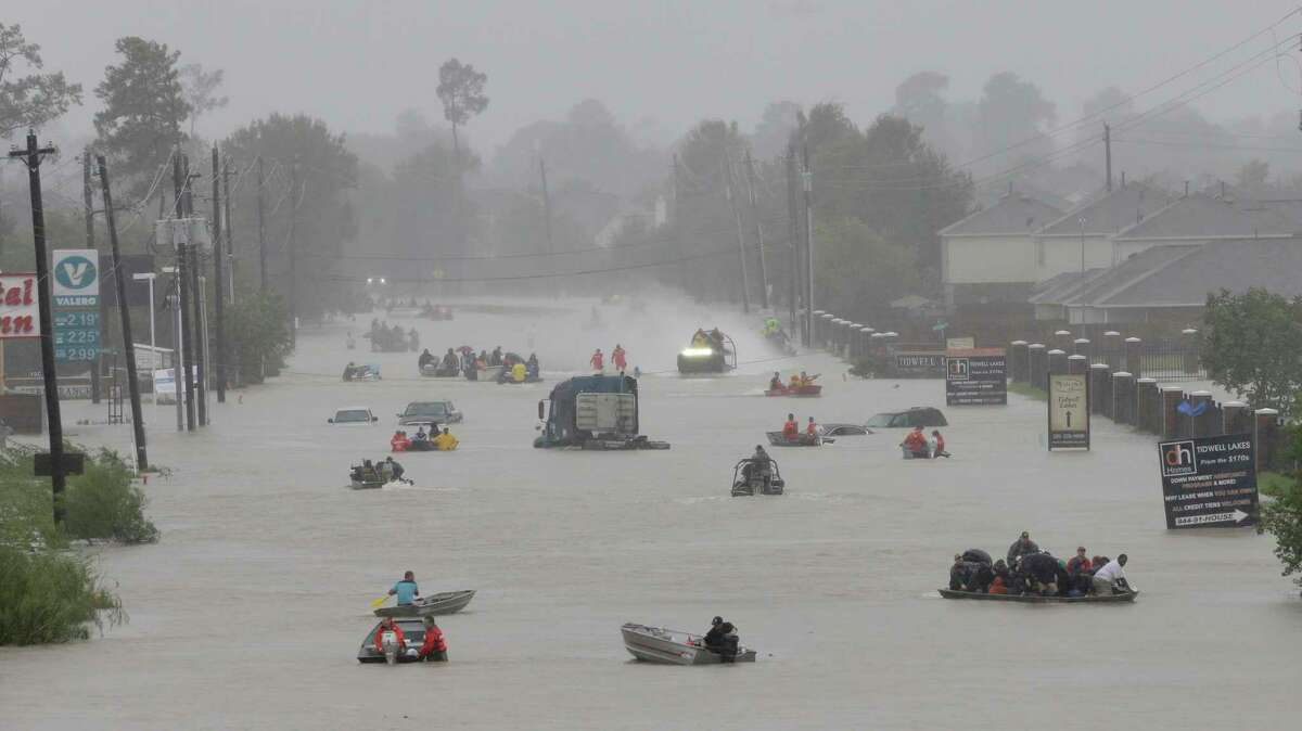 Rescue boats were plentiful after flooding from Hurricane Harvey. Financial relief has been slow.