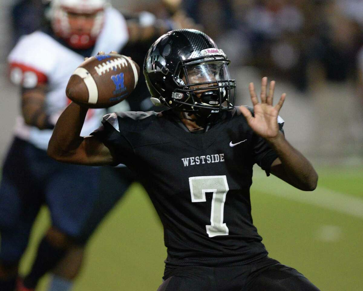 Akeem Benjamin (7) of Westside prepares to release a pass during the second quarter of a 6A Region III District 18 football game between the Lamar Texans and the Westside Wolves on Friday, October 4, 2019 at Delmar Stadium, Houston, TX.