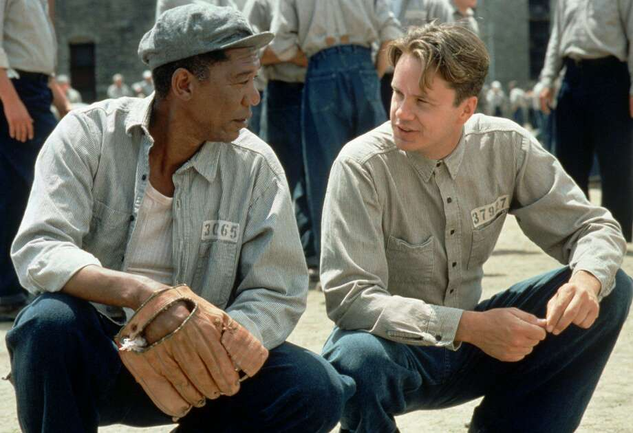 """ADVANCE FOR FRIDAY FEB. 10--Tim Robbins, right, and Morgan Freeman appear in a scene in the Castle Rock film """"The Shawshank Redemption"""" which, if nominated next week, is a favorite in several acting categories and a longshot for best picture in the Academy Awards. Despite the film's disappointing $16.7 million gross during the five months of North American release, there are tentative plans to re-release the prison drama if it receives the Oscar nomination nod. (AP Photo/Castle Rock, Michael Weinstein) Photo: MICHAEL WEINSTEIN / Castle Rock / CASTLE ROCK ENTERTAINMENT"""