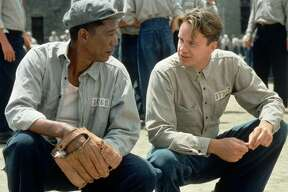 "ADVANCE FOR FRIDAY FEB. 10--Tim Robbins, right, and Morgan Freeman appear in a scene in the Castle Rock film ""The Shawshank Redemption"" which, if nominated next week, is a favorite in several acting categories and a longshot for best picture in the Academy Awards. Despite the film's disappointing $16.7 million gross during the five months of North American release, there are tentative plans to re-release the prison drama if it receives the Oscar nomination nod. (AP Photo/Castle Rock, Michael Weinstein)"