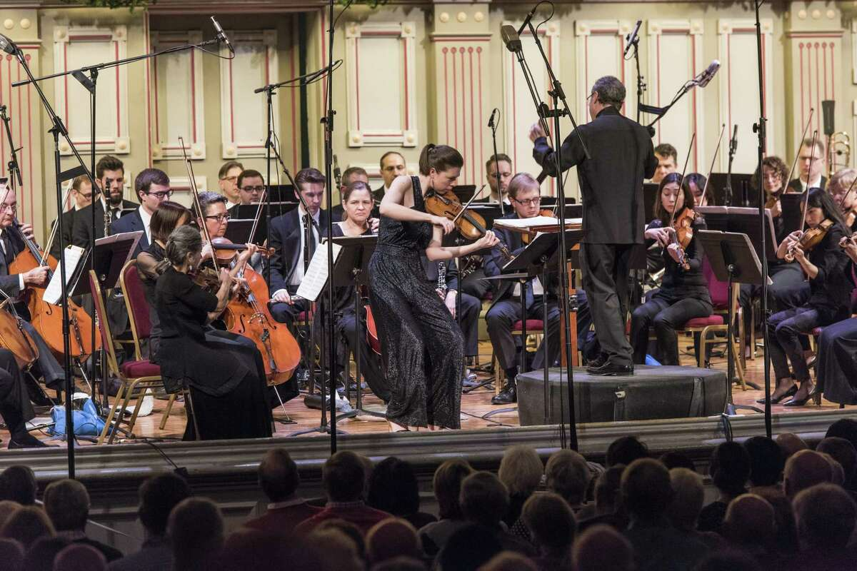 Violinist Tessa Lark performs with conductor David Alan Miller